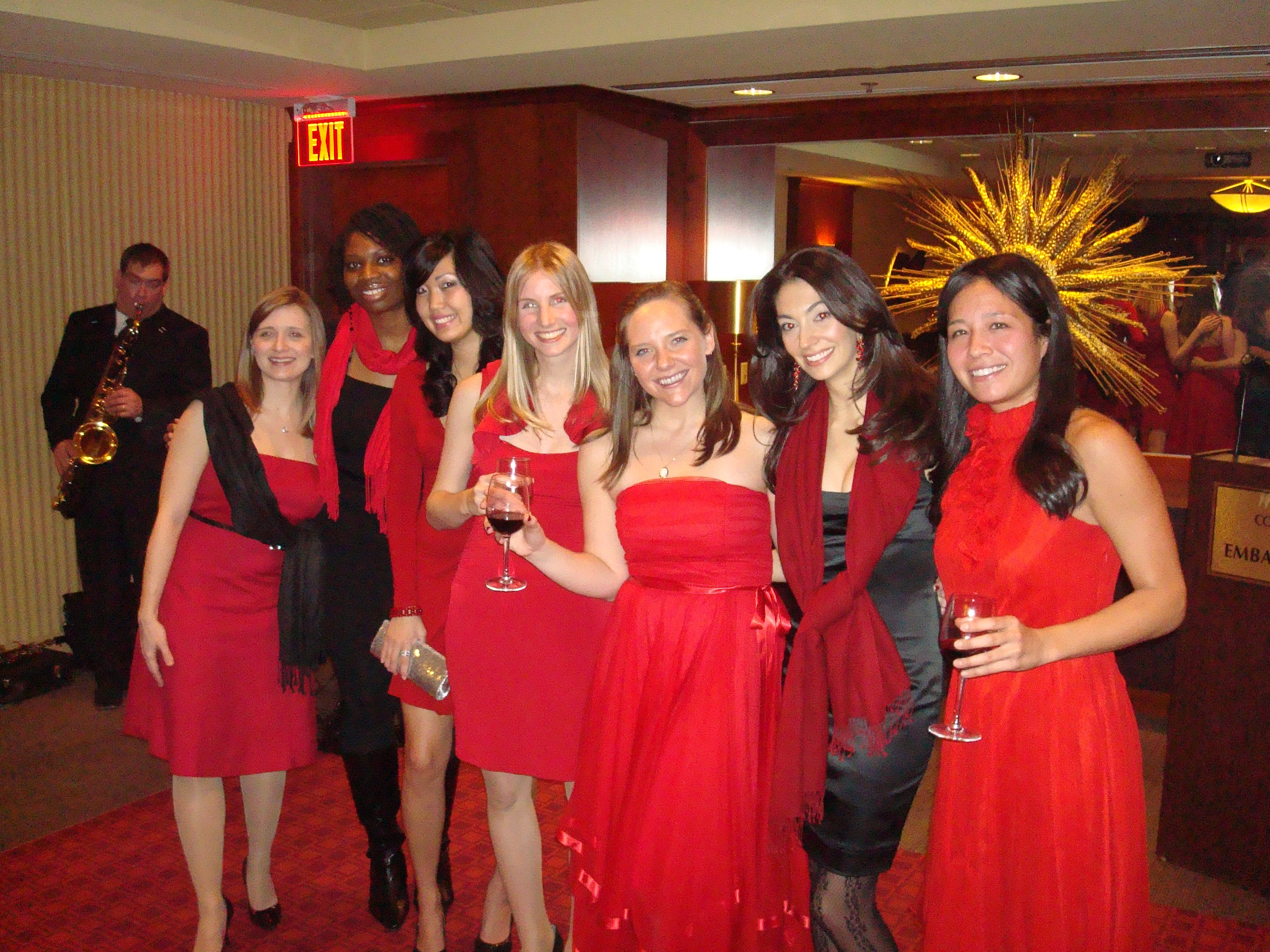 lady in red dress at the al smith dinner